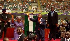 Gov Udom Emmanuel and wife, Martha kneeling to thank God
